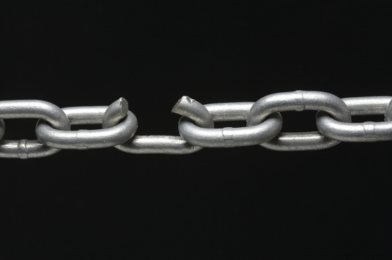 Broken metal chain on black background